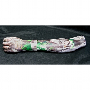 image: Prosthetic arm covering tattoo painting by Hudson Valley NY artist Katrie Arena.  hunting camo with glock logo.  Painted in 2012.